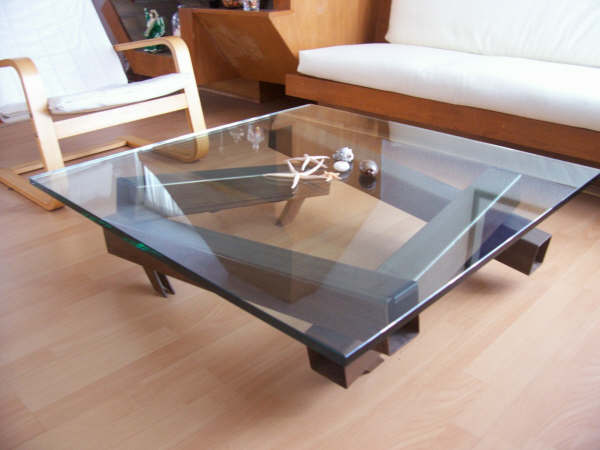 Unique shaped of exclusive centre table designs for Latest center table design